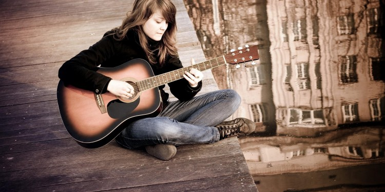 Girl-Playing-Guitar